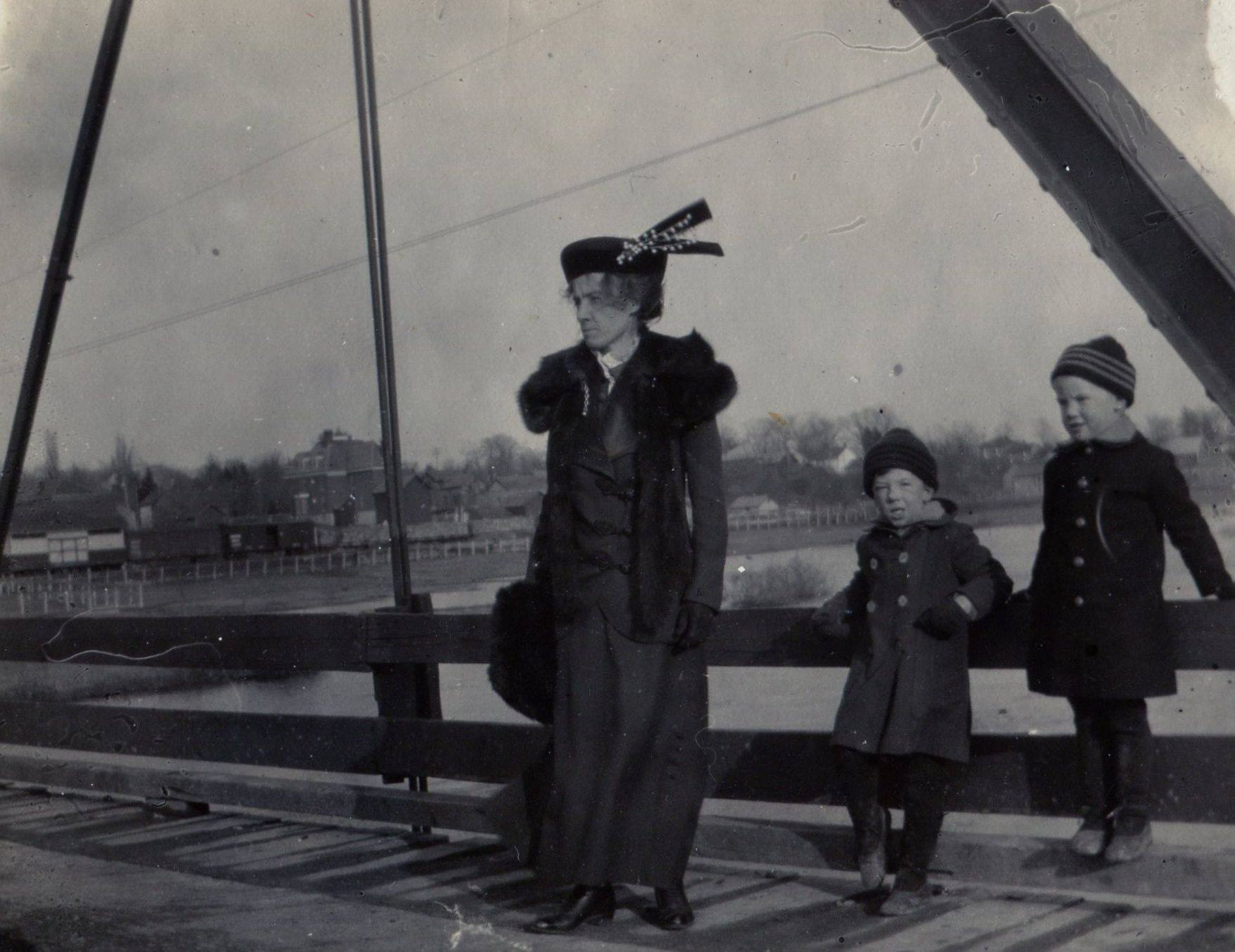 Catherine Brown Sanderson, Dougold and Magee on Crowe River Iron Bridge. Note train in the background.