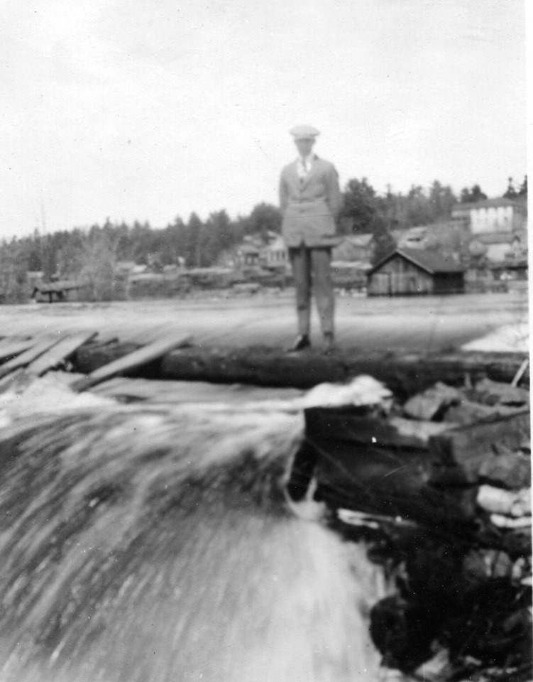 Ralph Neal  standing on the dam when it ran parallel to the shore.