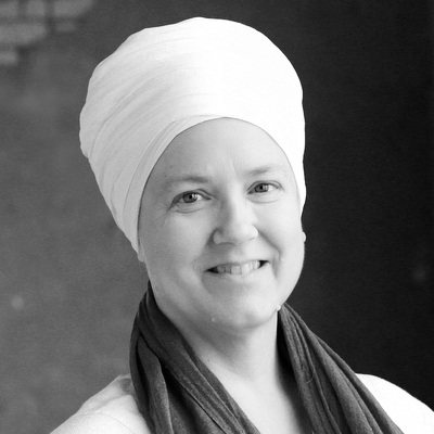 Sat Purkh Kaur - A KRI Certified Level Three Kundalini Yoga Teacher as well as Lead Trainer in the Aquarian Trainer Academy, Sat Purkh is known for her work in Sound & Mantra as well as Humanology and the Women's Teachings; in 2008 she authored Everyday Grace: The Art of Being a Woman, an introduction to the Women's Teachings of Yogi Bhajan.Sat Purkh joined the Kundalini Research Institute in 2006 and served as the Creative Director until the fall of 2013. A member of the Teacher Training Executive Council, she serves in developing the Three Levels of Teacher Training in Kundalini Yoga as taught by Yogi Bhajan®, and also served on the KRI Board of Directors from 2014-2017.She has eight albums of sacred music, Nectar of the Name, Beautiful Day: The Aquarian Sadhana, Queen Be: The Goddess Within, Love & Other Miracles, One: Love, Life, Light, The Pearl: Maiden, Mother, Crone, The Guru Within, and Across the World Ocean. She lives with her husband and their menagerie of animals, and is always at work on her next album of sacred music.