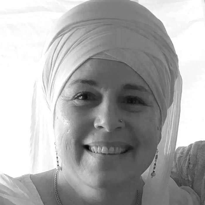 Devta Kaur, E-RYT, LMT - A senior Teacher trained in various lineages such as classical Hatha, Kriya Yoga, Kundalini Yoga, Bhakti Yoga, Osho Dynamic Meditations, and Core Strength Vinyasa. Has diverse fitness and bodywork background with 27+ years of teaching experience and 800-hours of formal yoga training. Certified with the Kundalini Research Institute as a Level I Kundalini Yoga Teacher. Certified through International Yoga Alliance as a RYT-200 in Dharamsala, India and Yoga Alliance as a 200-hour E-RYT.http://totalbodysolutions.net/denys-story/