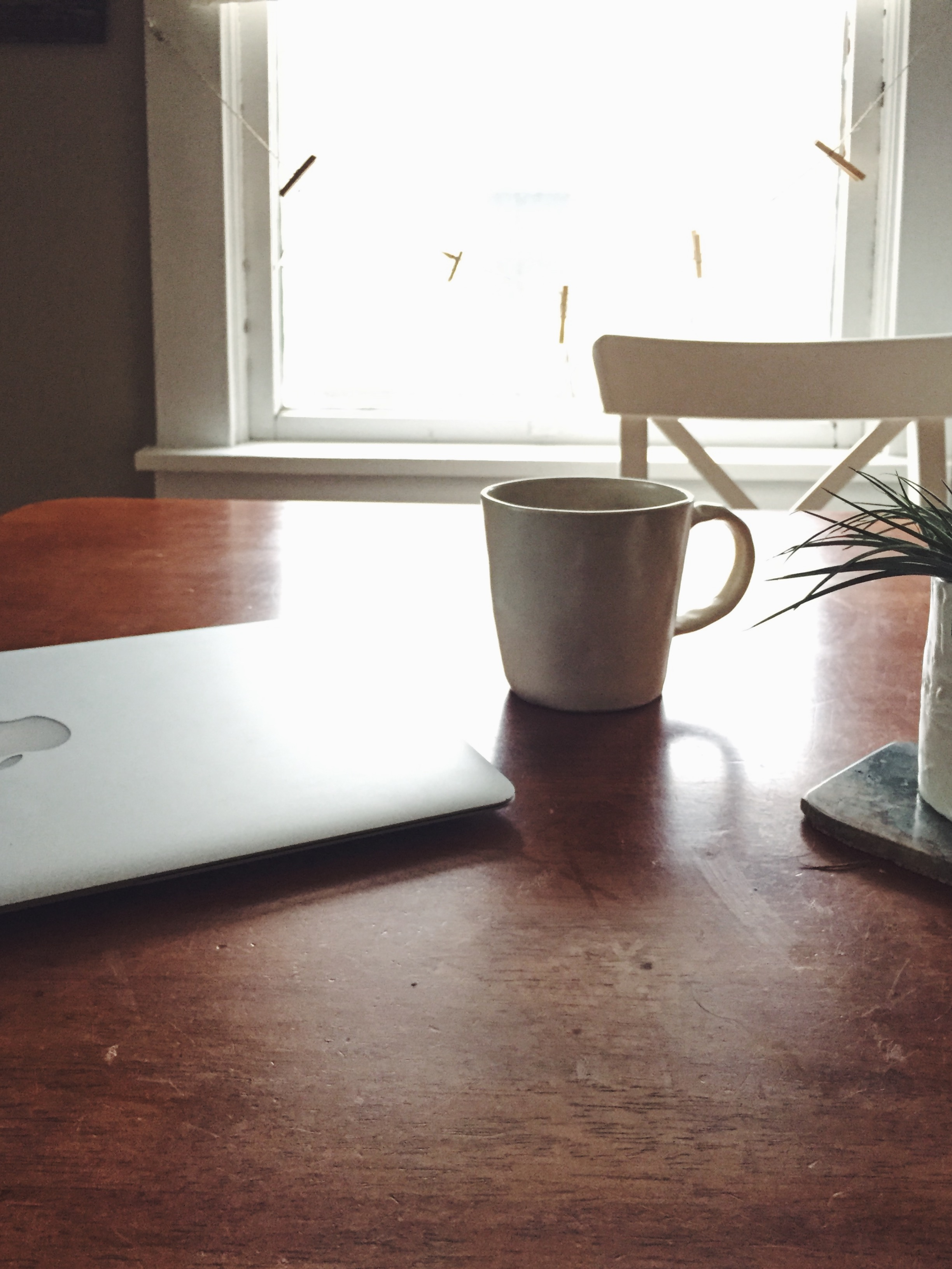 My desk at the kitchen table with my favorite cup.