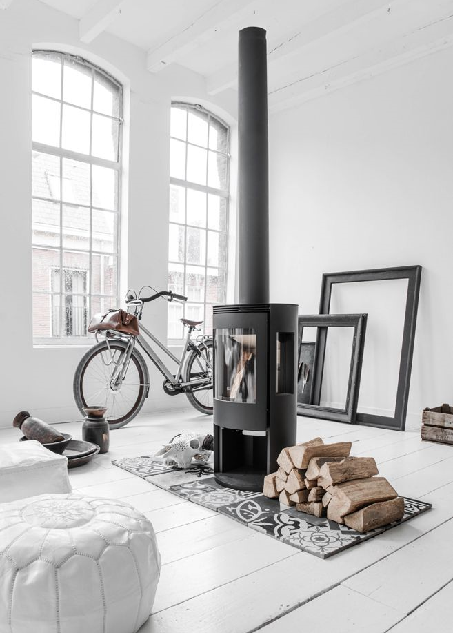 The idea of living in this loftspace  with these tall windows anda little fireplace.