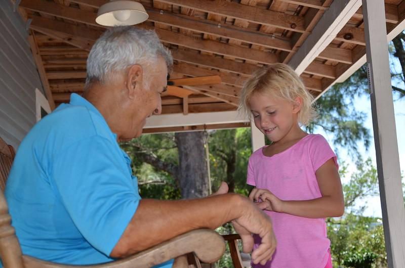 Camper Katherine Schwartzel listens to Ralph Woodring's shrimp boat stories.