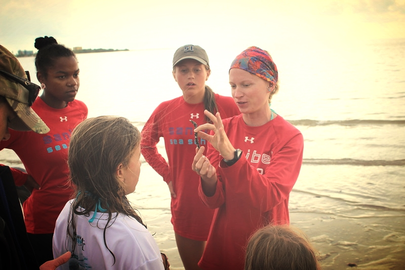Counselor Nicole Finnicum teaches campers about marine worms at Bunche Beach.