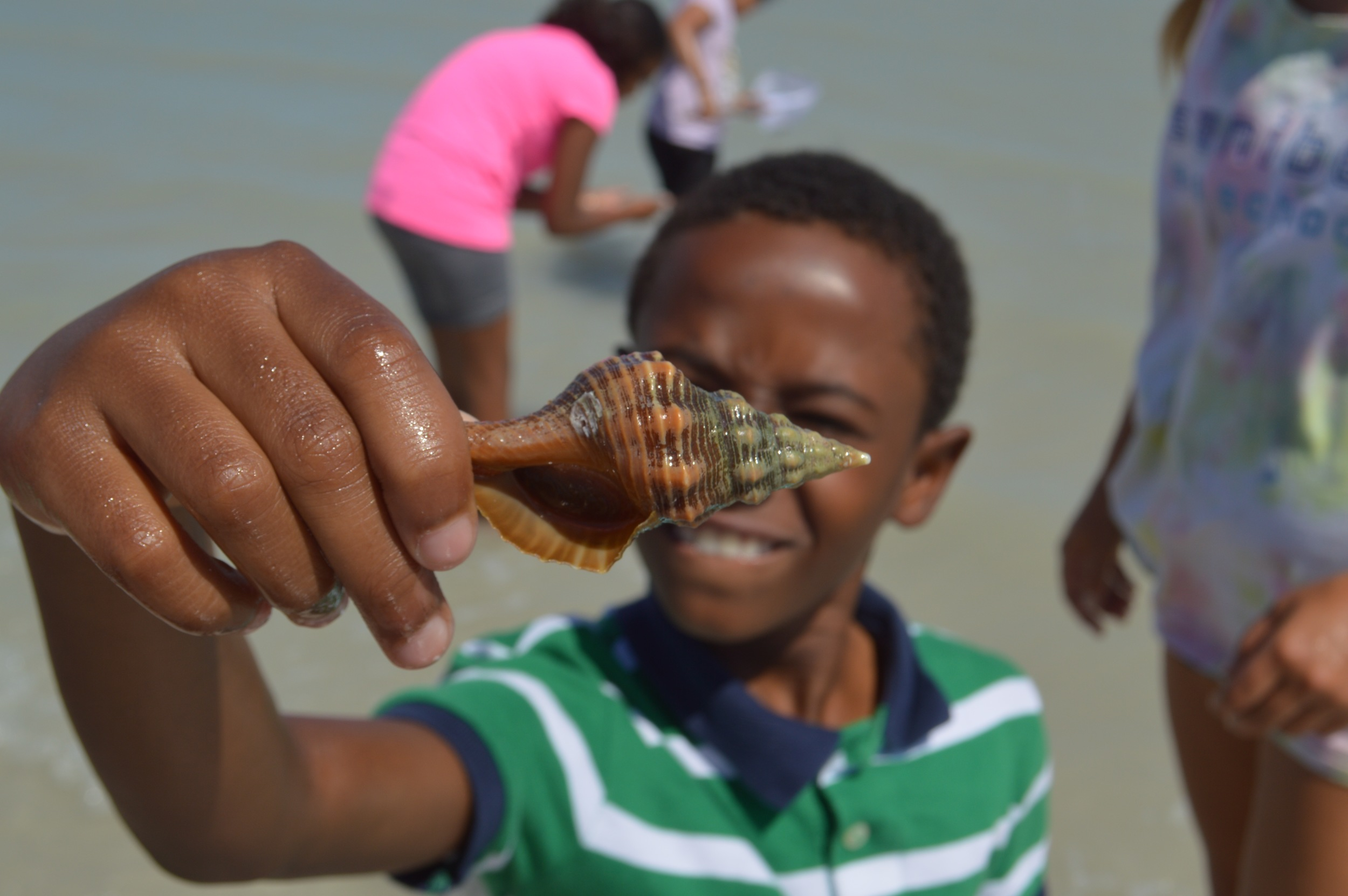 A student from the Heights Foundation, a Sanibel Sea School partner organization, explores the ocean during filming.