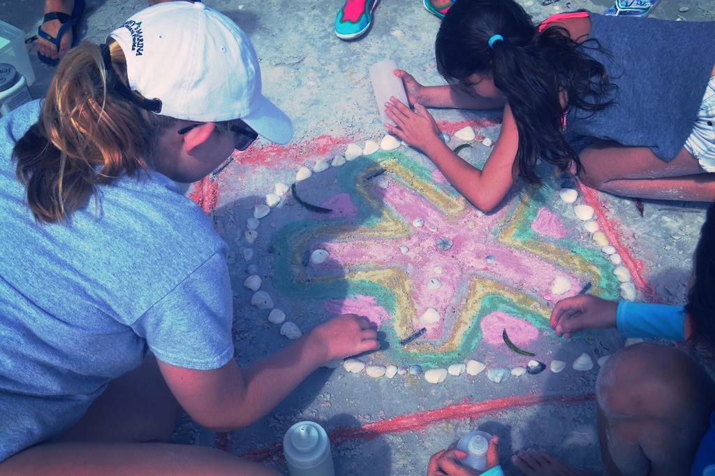 Campers created a sand dollar-inspired mandala on the beach.