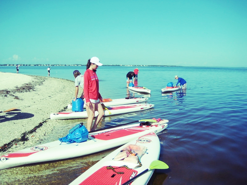 Have Paddleboard, Will Survive campers arrive at Picnic Island for an overnight test of their survival skills.