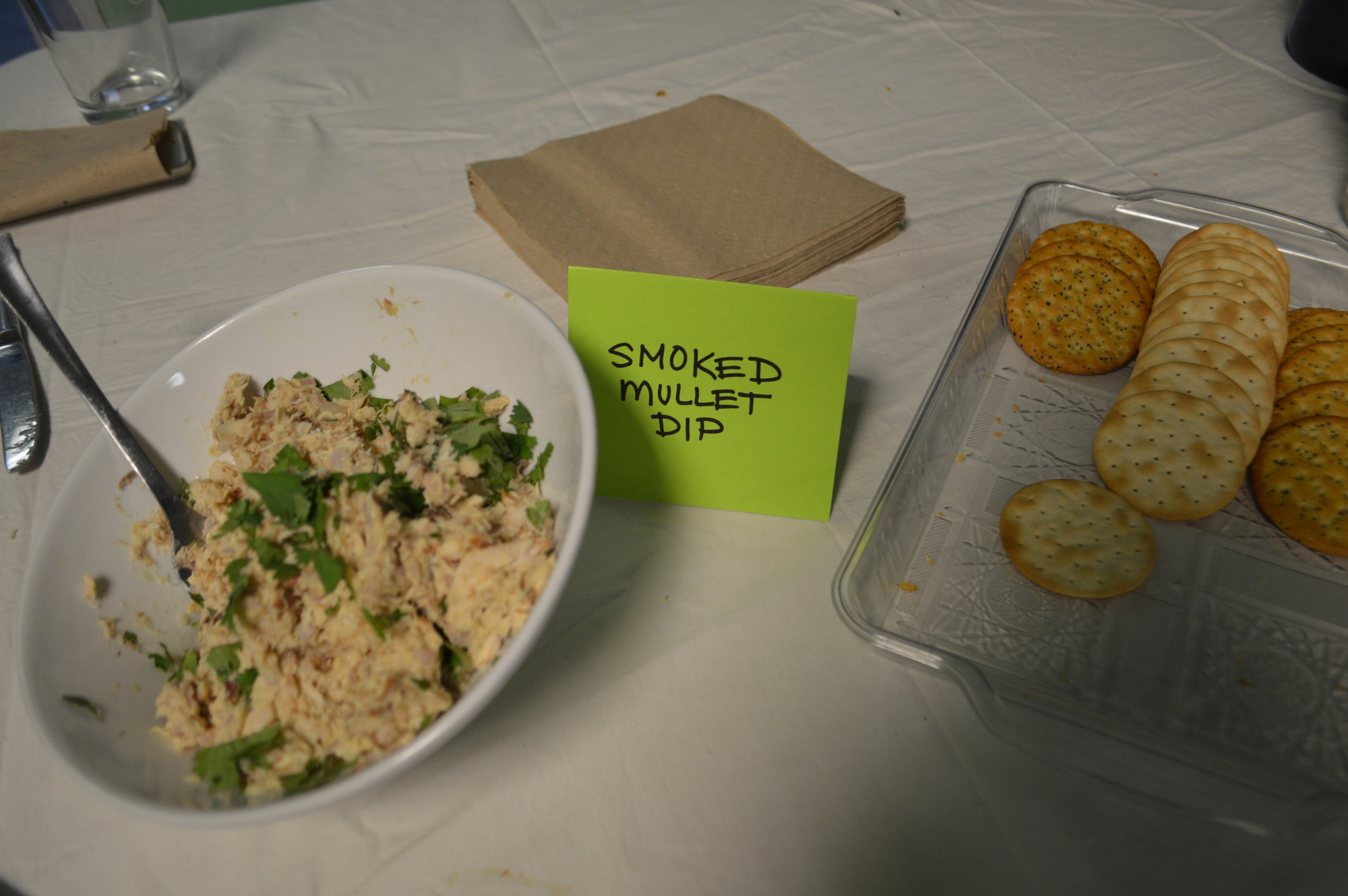 Smoked mullet dip served with crackers.