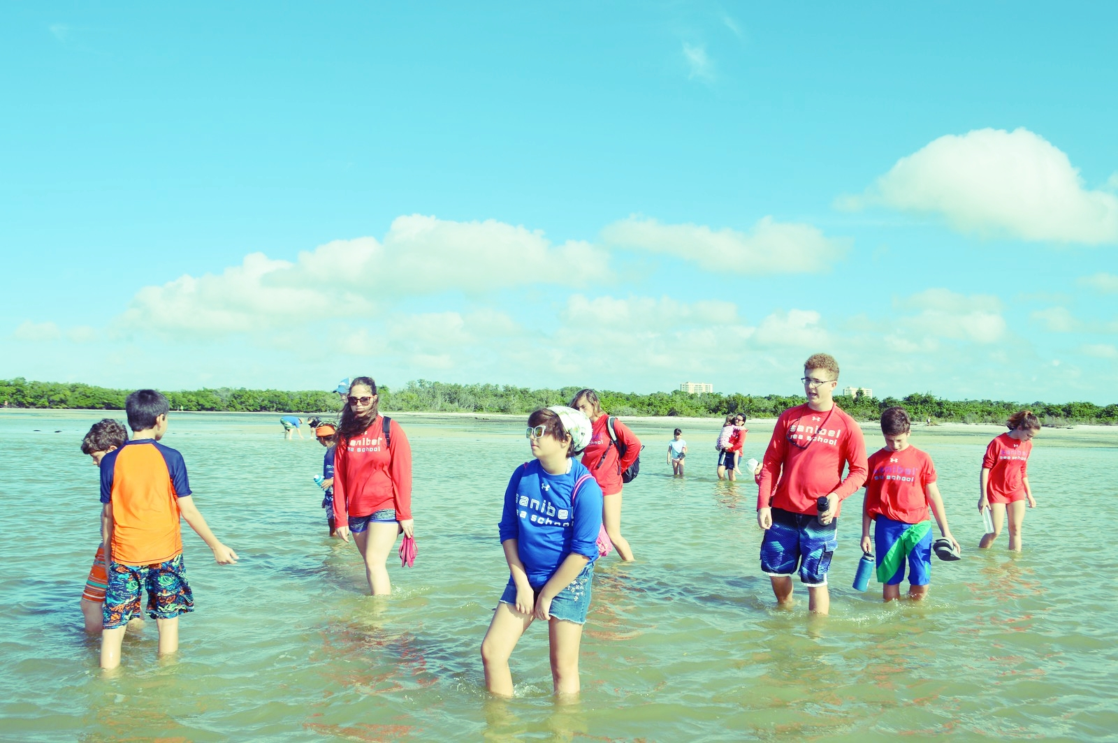 Campers wade on the sandbar at Bunche Beach.