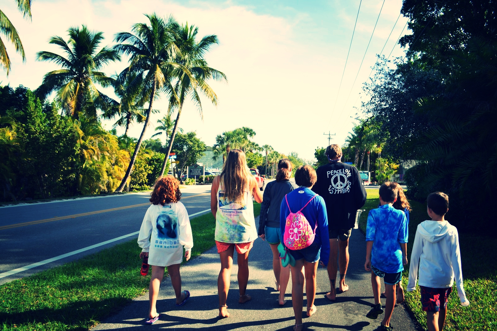 """Campers walk to the beach during Sanibel Sea School's annual """"Give Your Troubles to the Sea"""" ceremony."""
