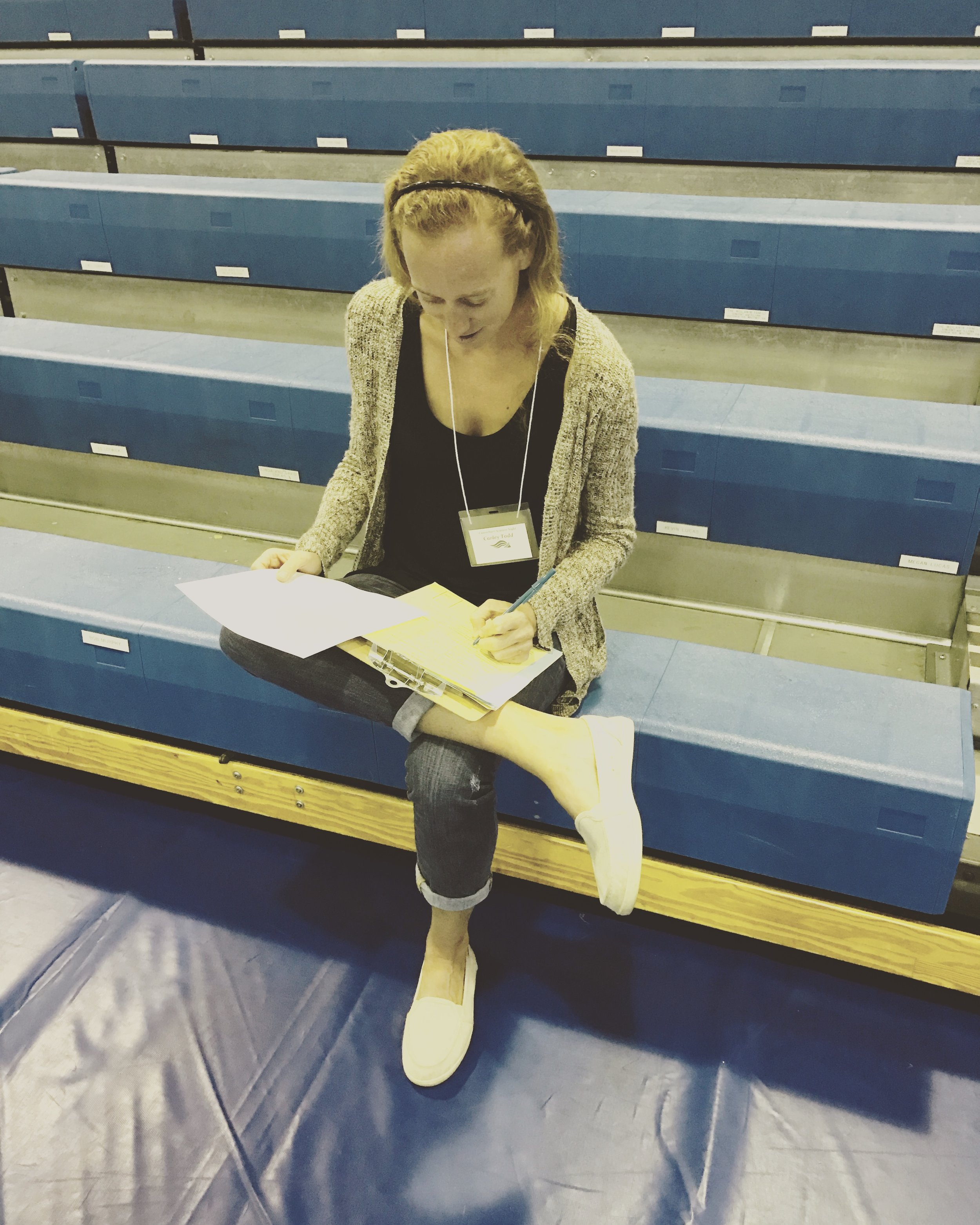 Carley Todd takes a break to make notes on her score sheet.