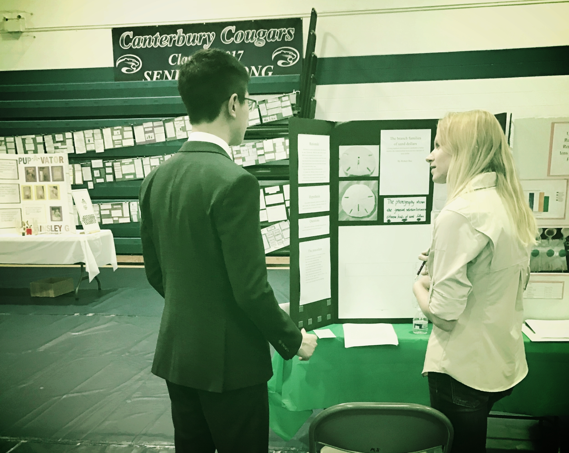 Nicole Finnicum Interviews a student about his science fair research.
