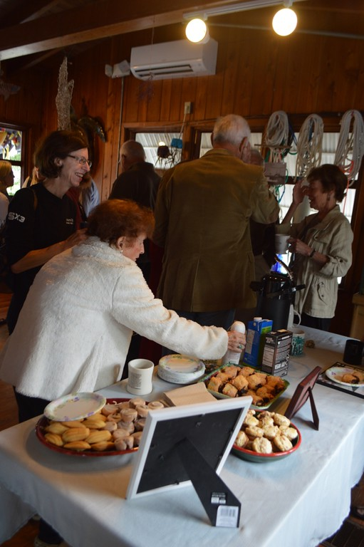Attendees enjoy coffee and pastries in the Richard C. Kennedy Building.