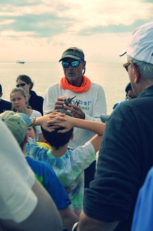 Doc Bruce talks about the lightning whelk's life cycle during Sanibel Sea School's November Beach Walk.