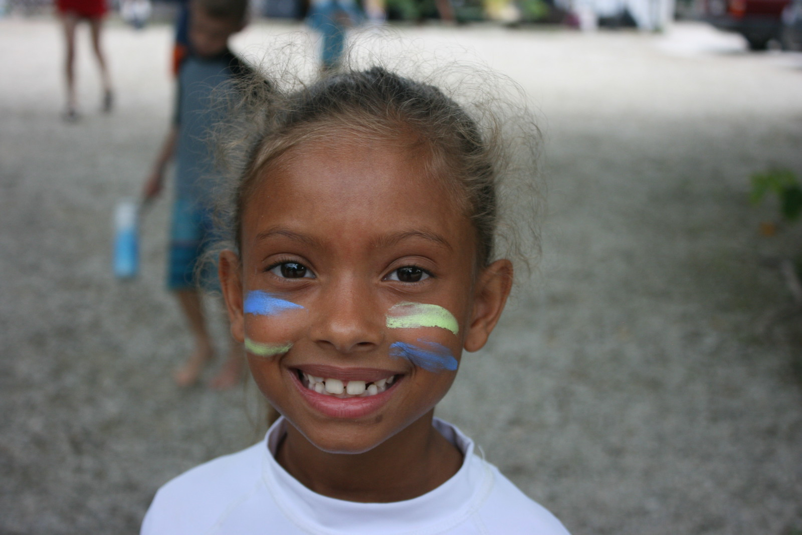 Campers showed their team spirit with face paint in their surfboard paddling team colors.