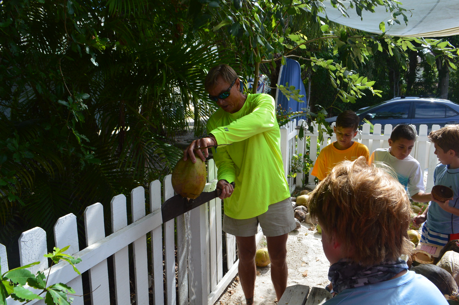 Doc Bruce demonstrated how to crack a coconut open.