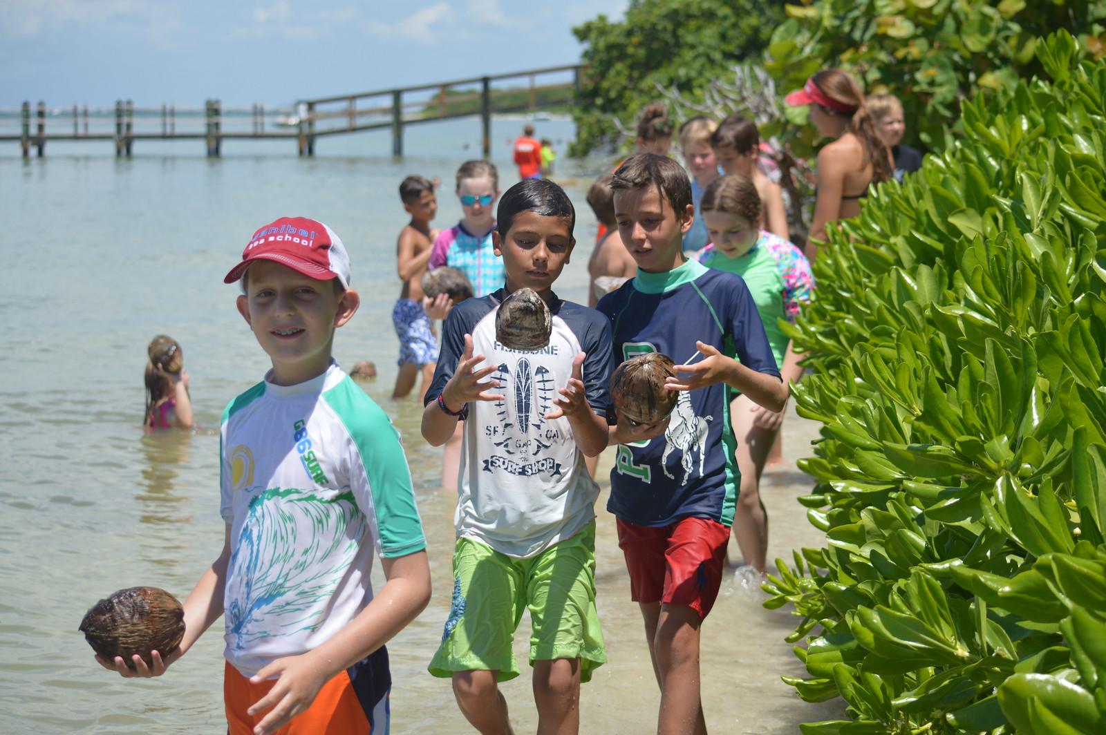 Participants released coconuts into San Carlos Bay.