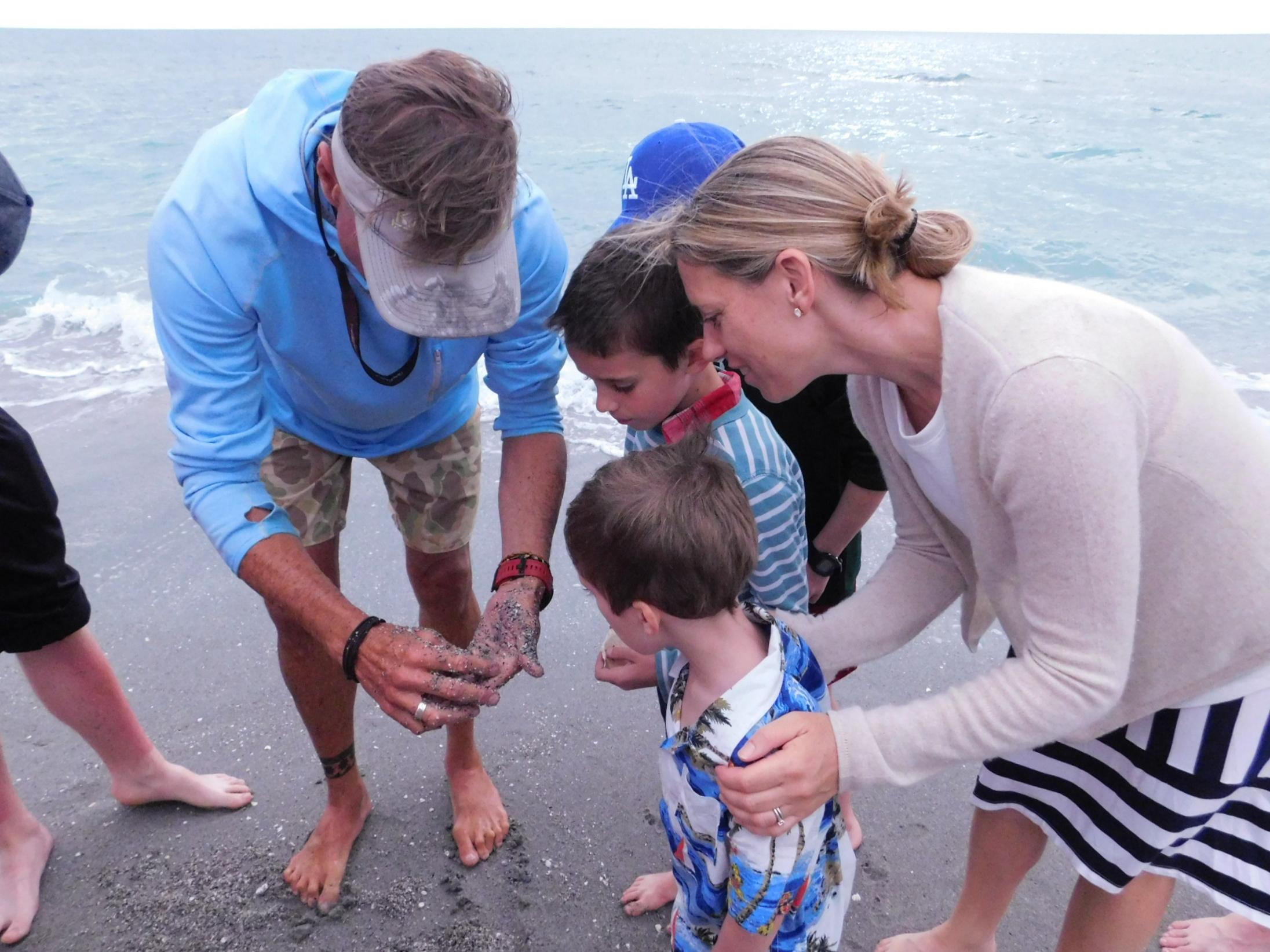 Dr. Bruce Neill led a beach walk for members of the Captiva Yacht Club. Photo courtesy of Captiva Yacht Club.