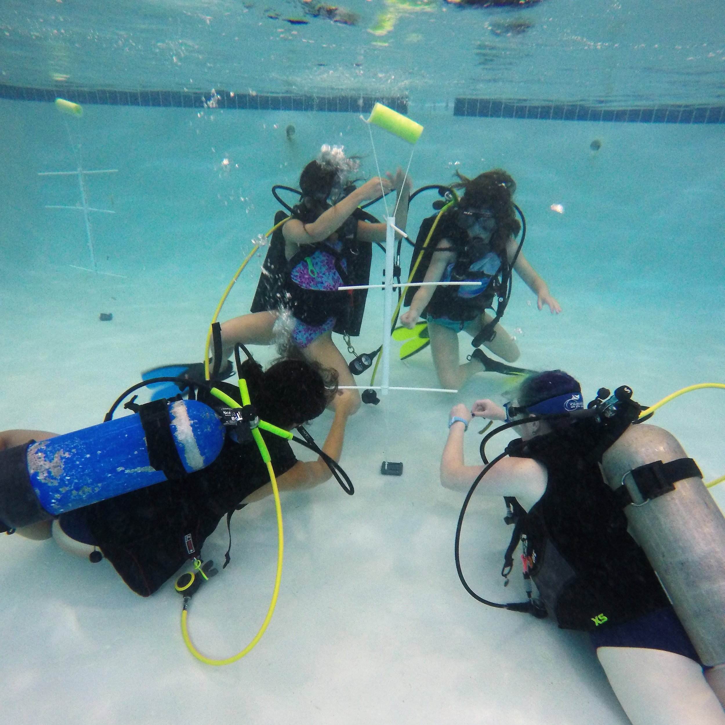 Workshop participants learned the basics of scuba diving and built PVC coral trees, which are widely used in coral reef restoration projects.