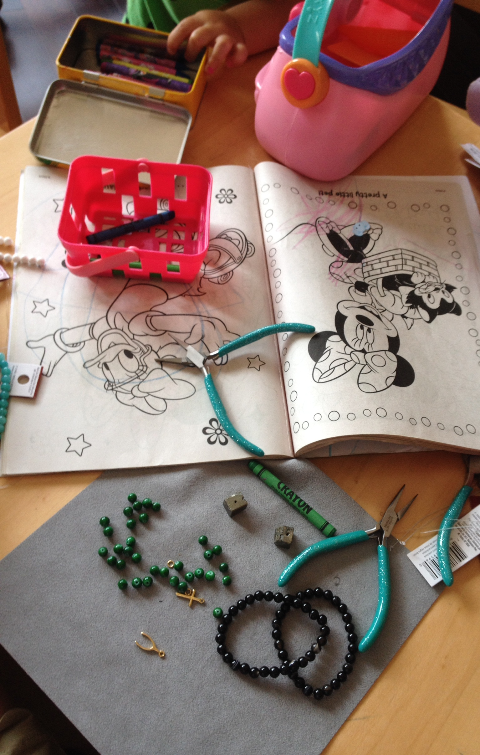 A Minnie Mouse coloring book, beads, charms, and crayons. Sounds like a party to me!