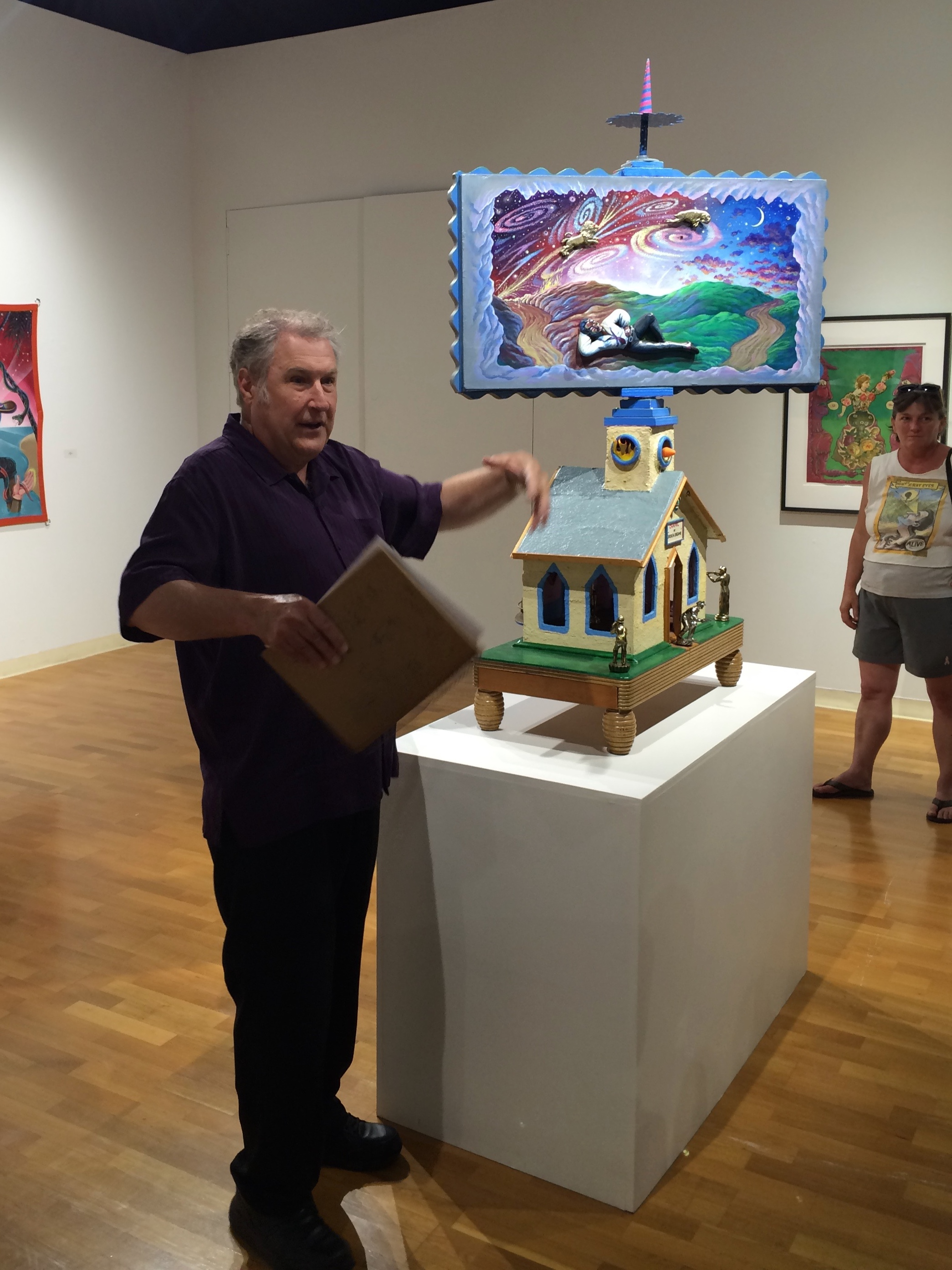 2015 , Glen speaking at a retrospective of his work in Bloomington, Illinois