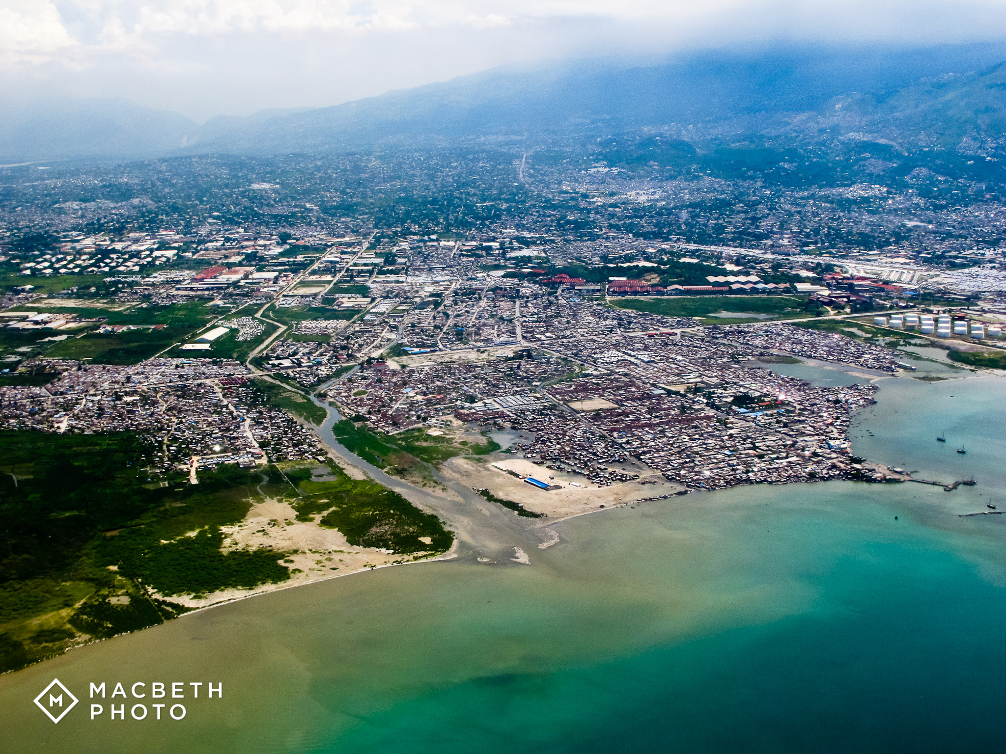 """Flying in, Jim shot this aerial image of Port au Prince. This is a largely crowded area in the center of Cite Solie, considered the poorest """"slum"""" in the city."""