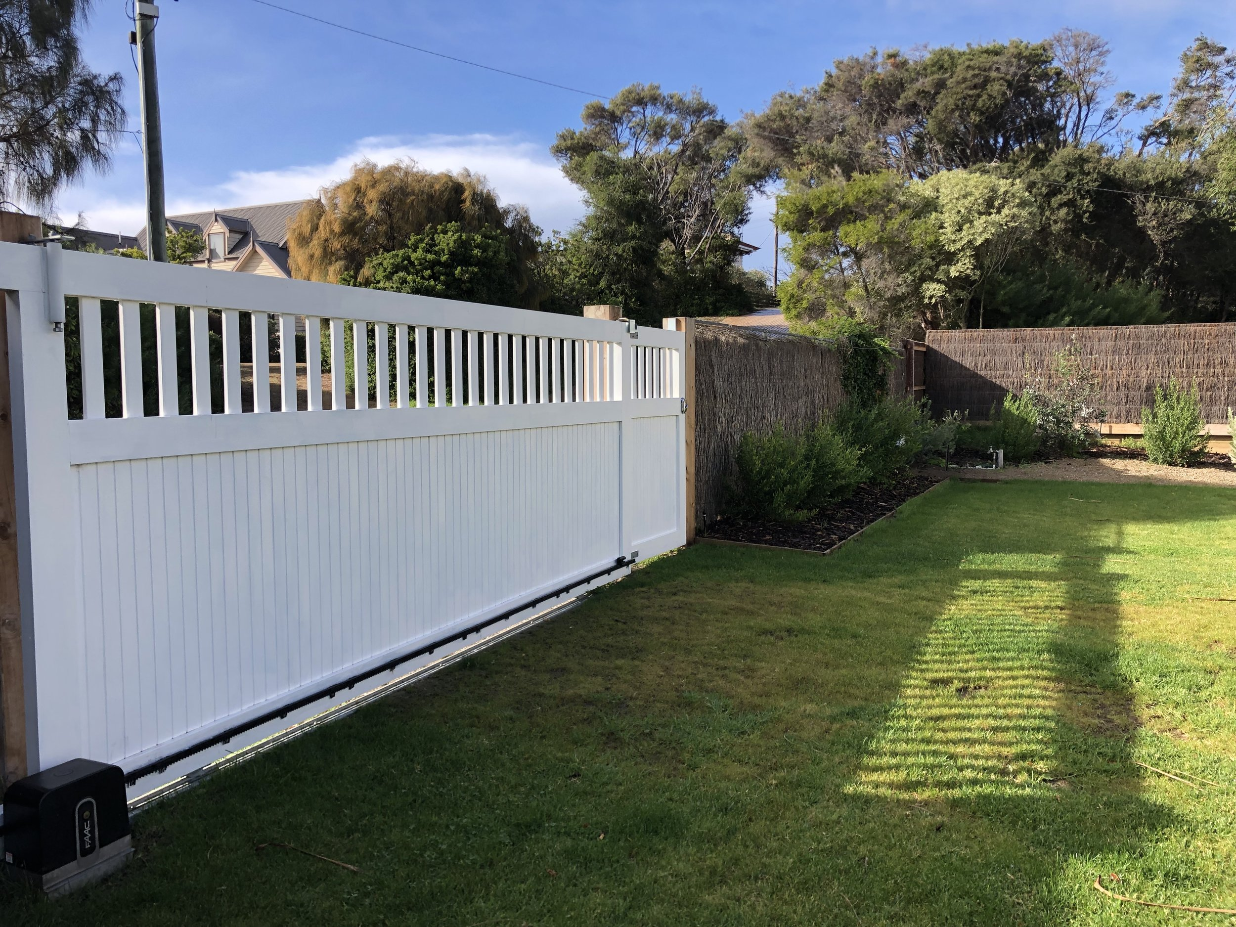 Sliding gates and motors built and installed by Peninsula Timber Gates.jpg