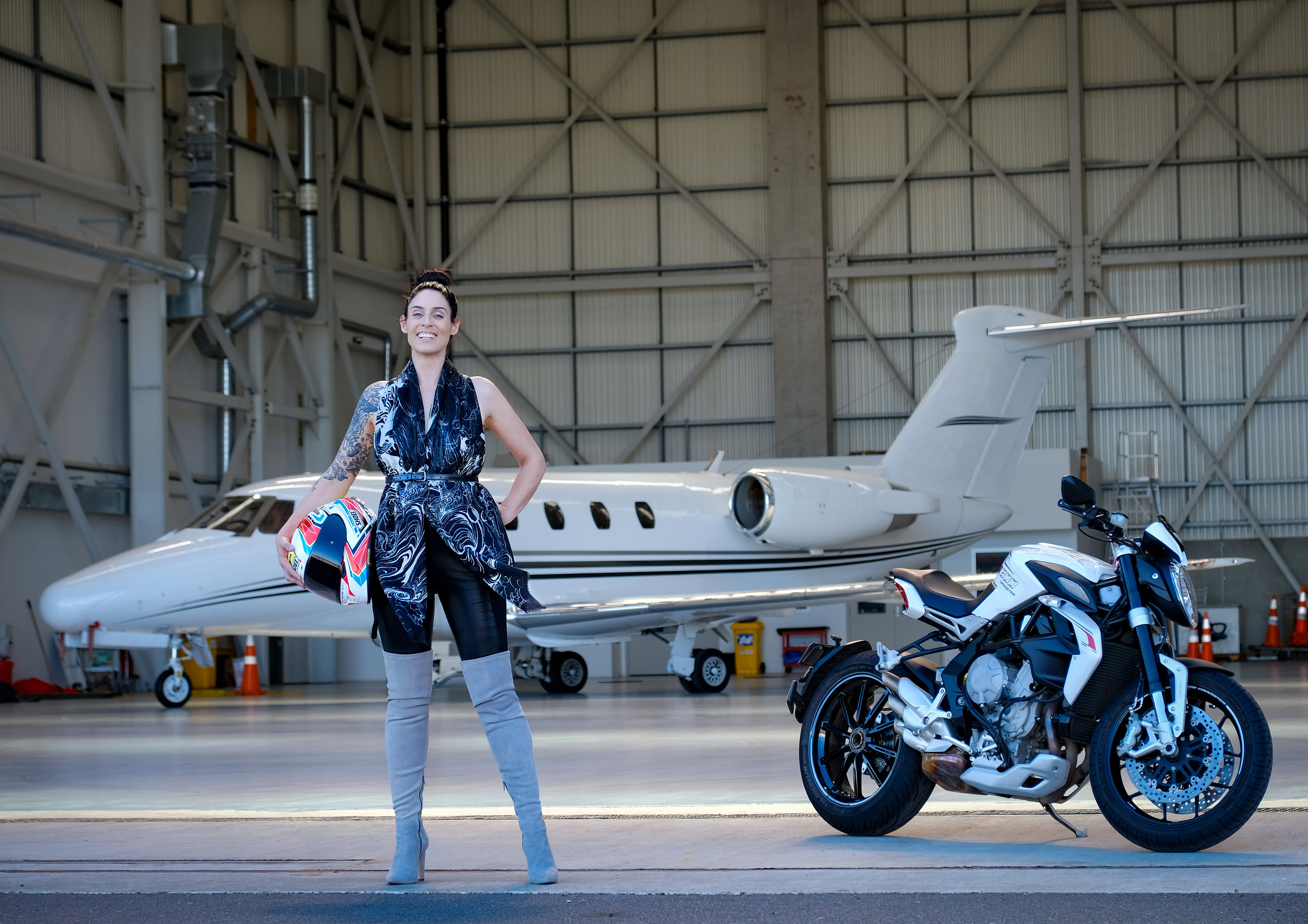 Moena Moxham wears 'Metamorphosis' as a top next to two of her two greatest passions; flying and motorbiking. This is her MV Agusta Brutale Dragster RR and she is working towards her pilots licence.