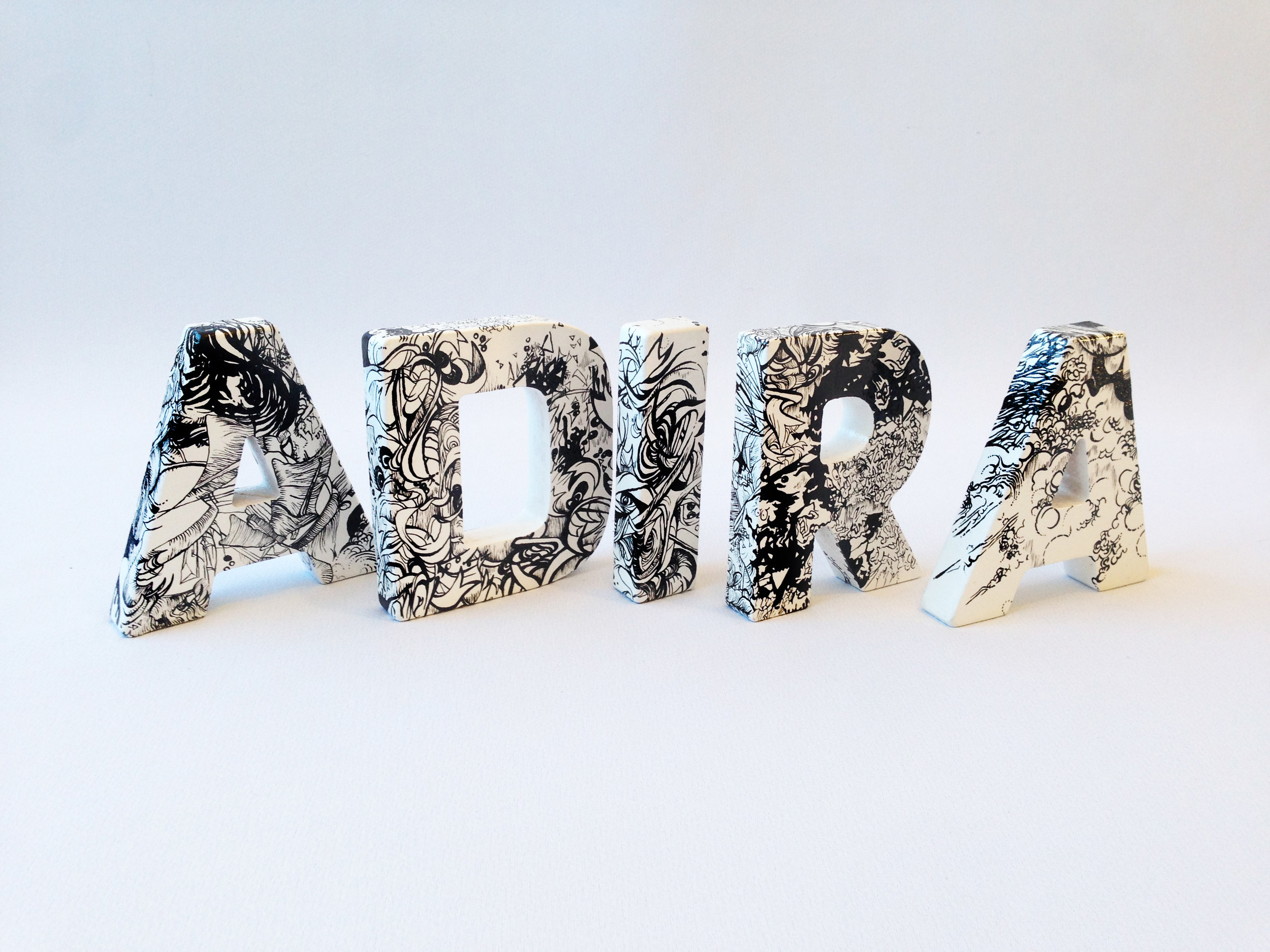 'Mother's Love' , Hand painted letters of Moxham's daughter's name 'Adira', Humbrol enamel, 460 x 110 x 18mm (when lined up), Unique, 2019.  - Spot the difference in the photos :)