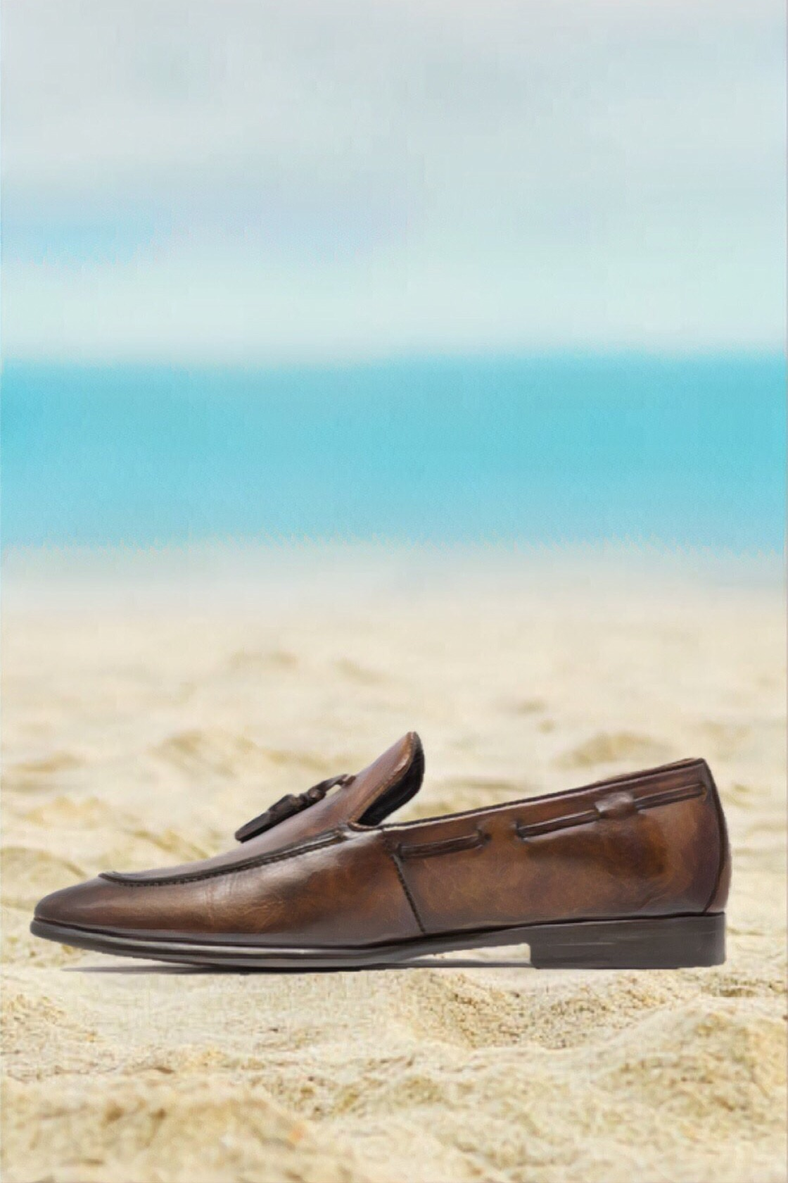 THE 403 RB CALFSKIN LOAFER - A rustic touch is sometimes the best way to relax. This breathable and elegant design in a smoked oak finish will keep you cool while still looking your best.Be sure to keep your no-show socks on to avoid ruining the tropical scent.