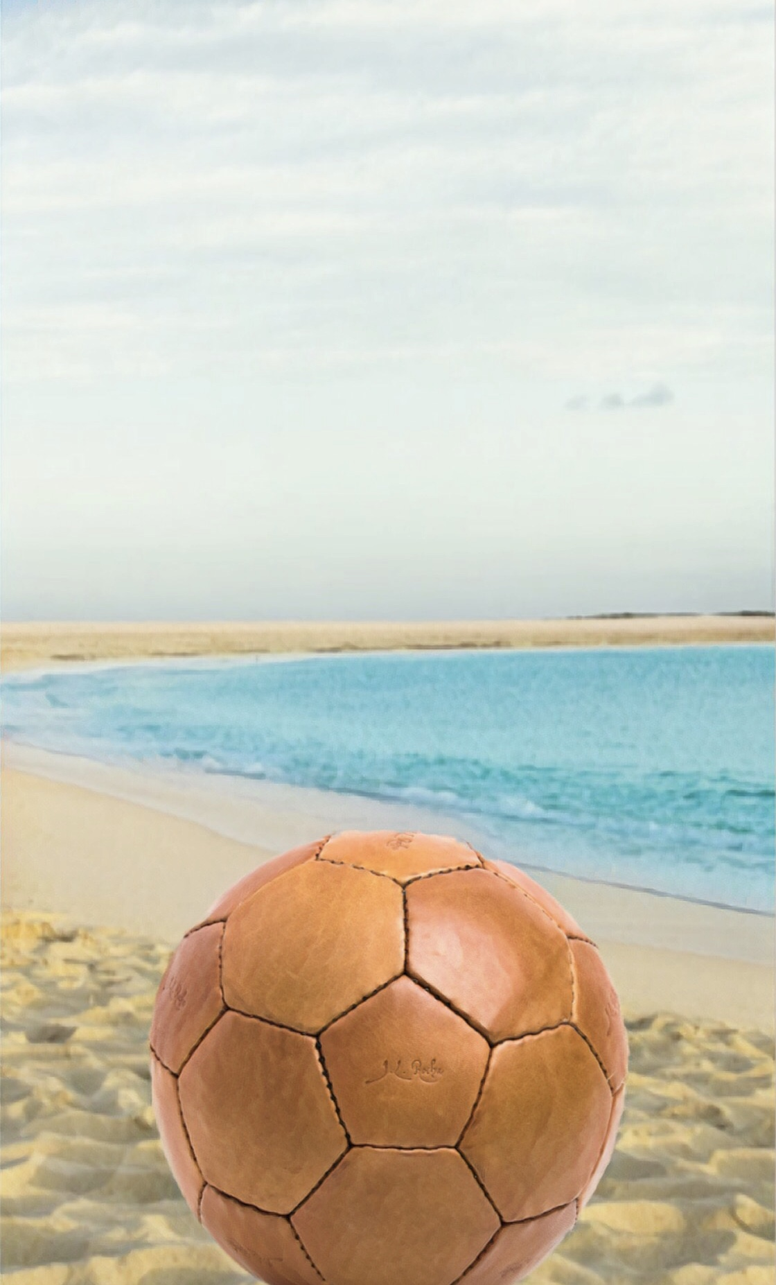 Vintage 1950's Soccer Ball - What's all work without a little play? Sometimes a vacation is more than just about a spa day and some pampering. Beach soccer is the perfect way to pump up the heart rate in style. Take your collectors edition soccer ball and show them how a dapper man dribbles.