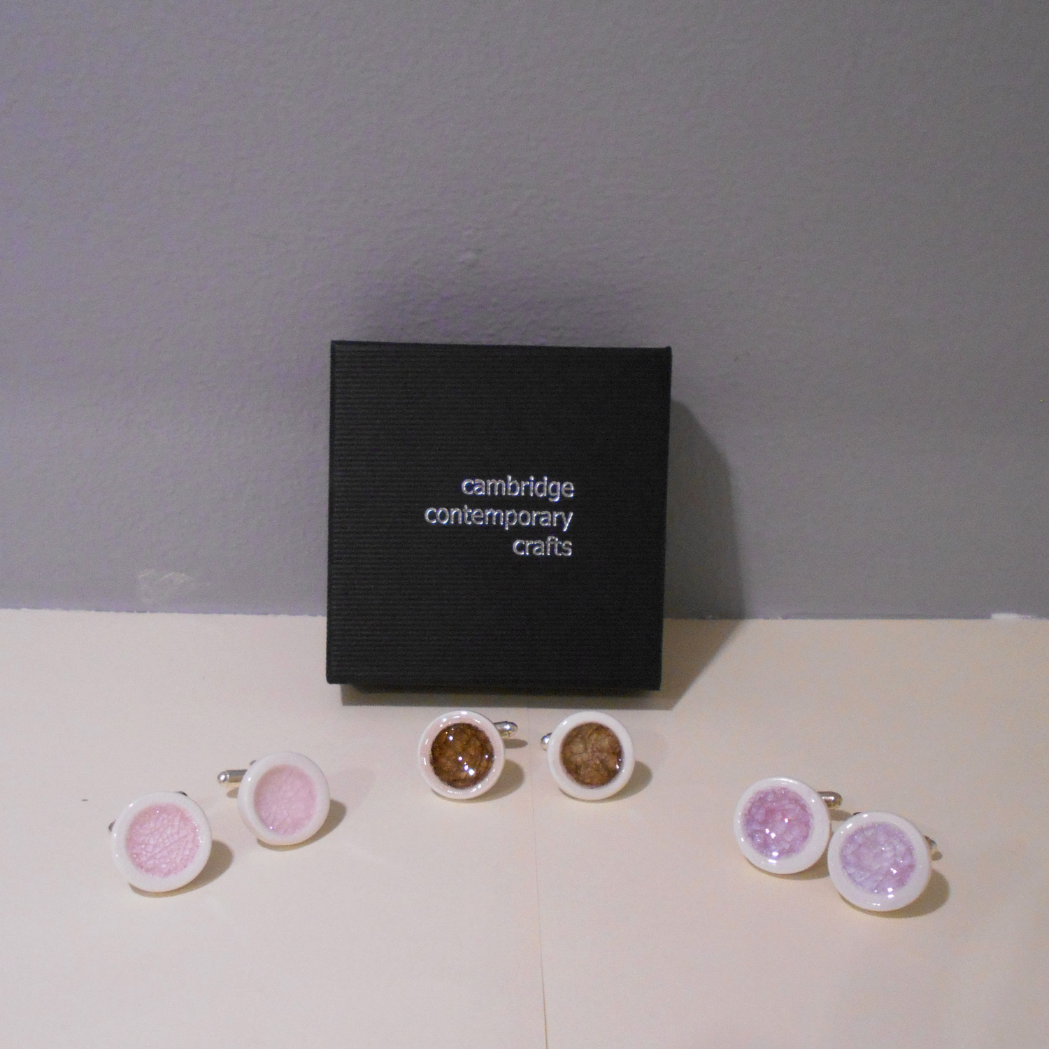 Jamie Parks   Cufflinks in Pink, Brown and Purple  porcelain and glass  £18  per pair