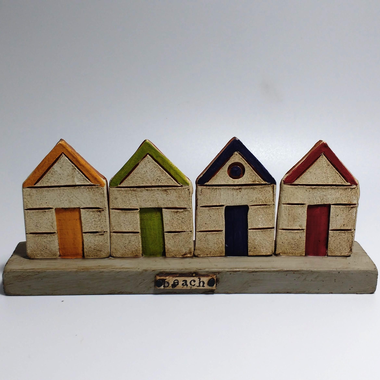 4 Beach Huts  Ceramic on Wooden Plinth  £40