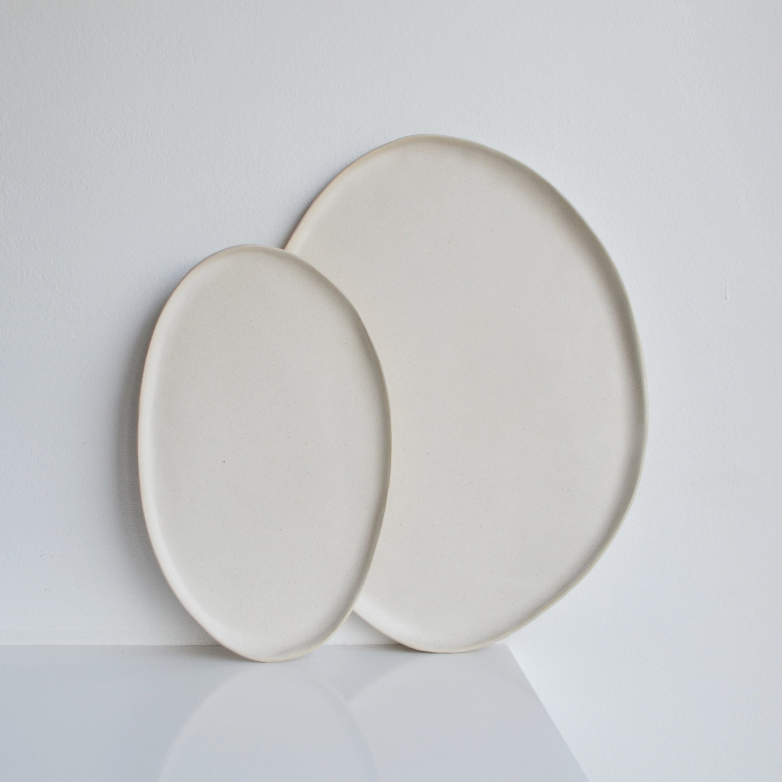 Satin Cream Oval Platters  ceramic  Small: 21 x 13 cm approx.   £25  Large: 33 x 20 cm approx.   £ 45