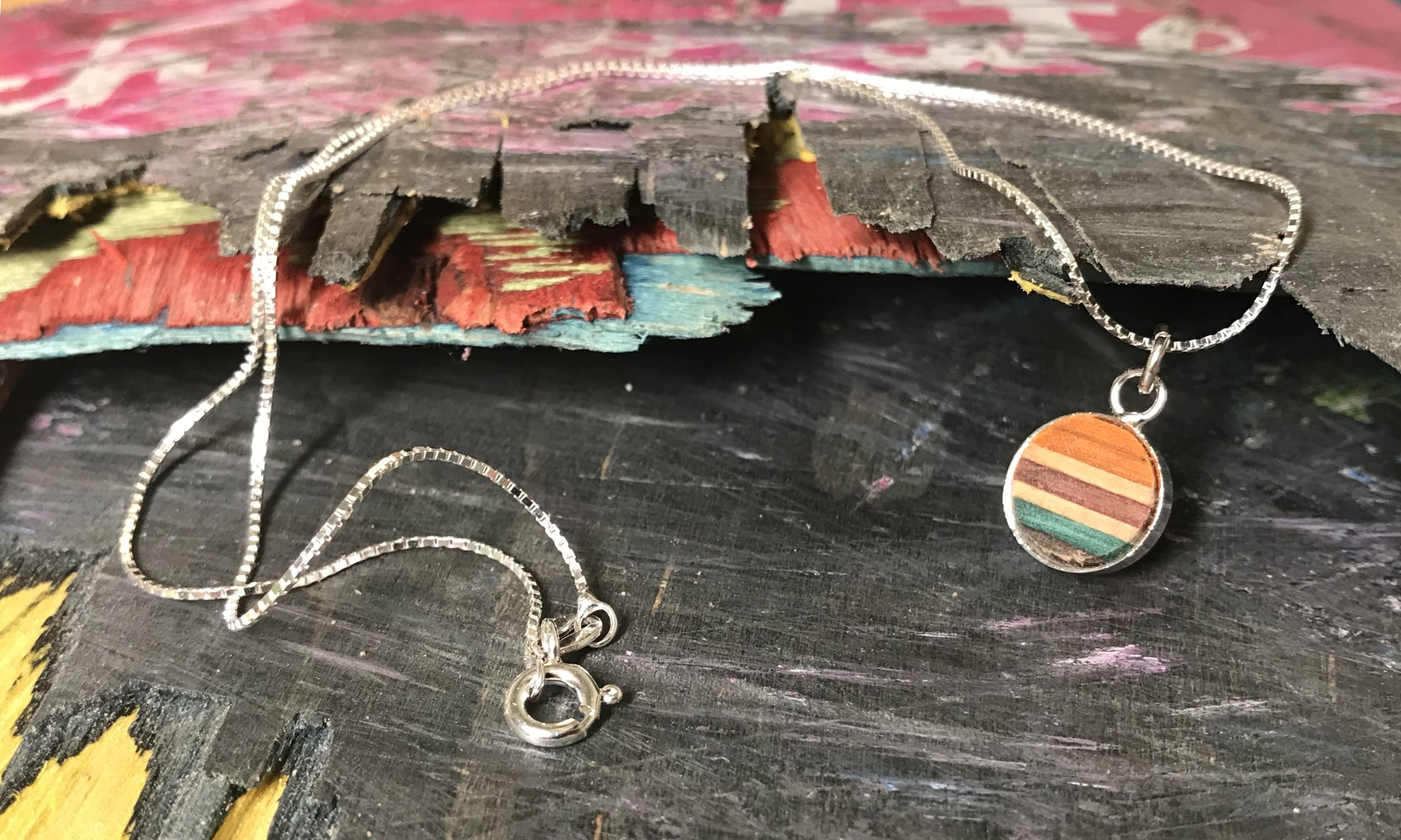"""Necklace  Recycled Skateboard and Sterling Silver  1 x 1 cm, chain 16""""  £38"""