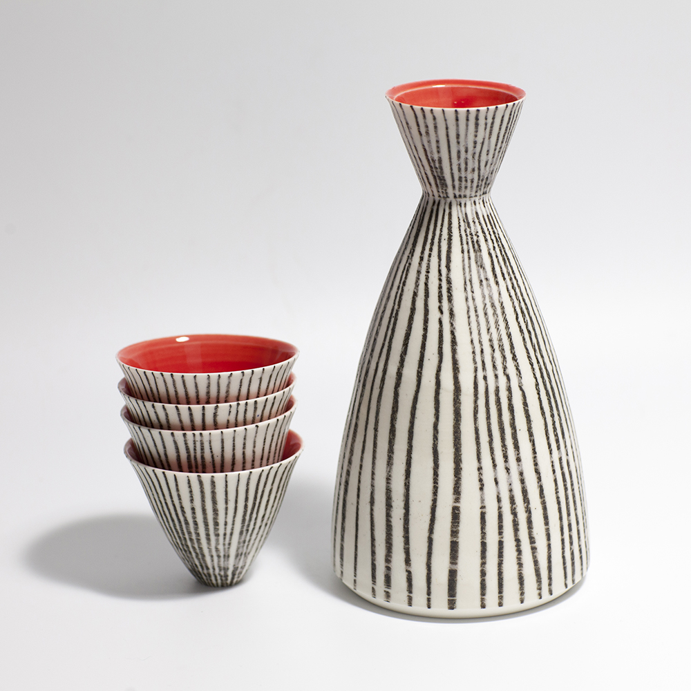 Monochrome Sake Set: Red Interior  Ceramic  18.5 x 10 x 10cm (bottle)  6 x 7 x 7 (cups)  £160