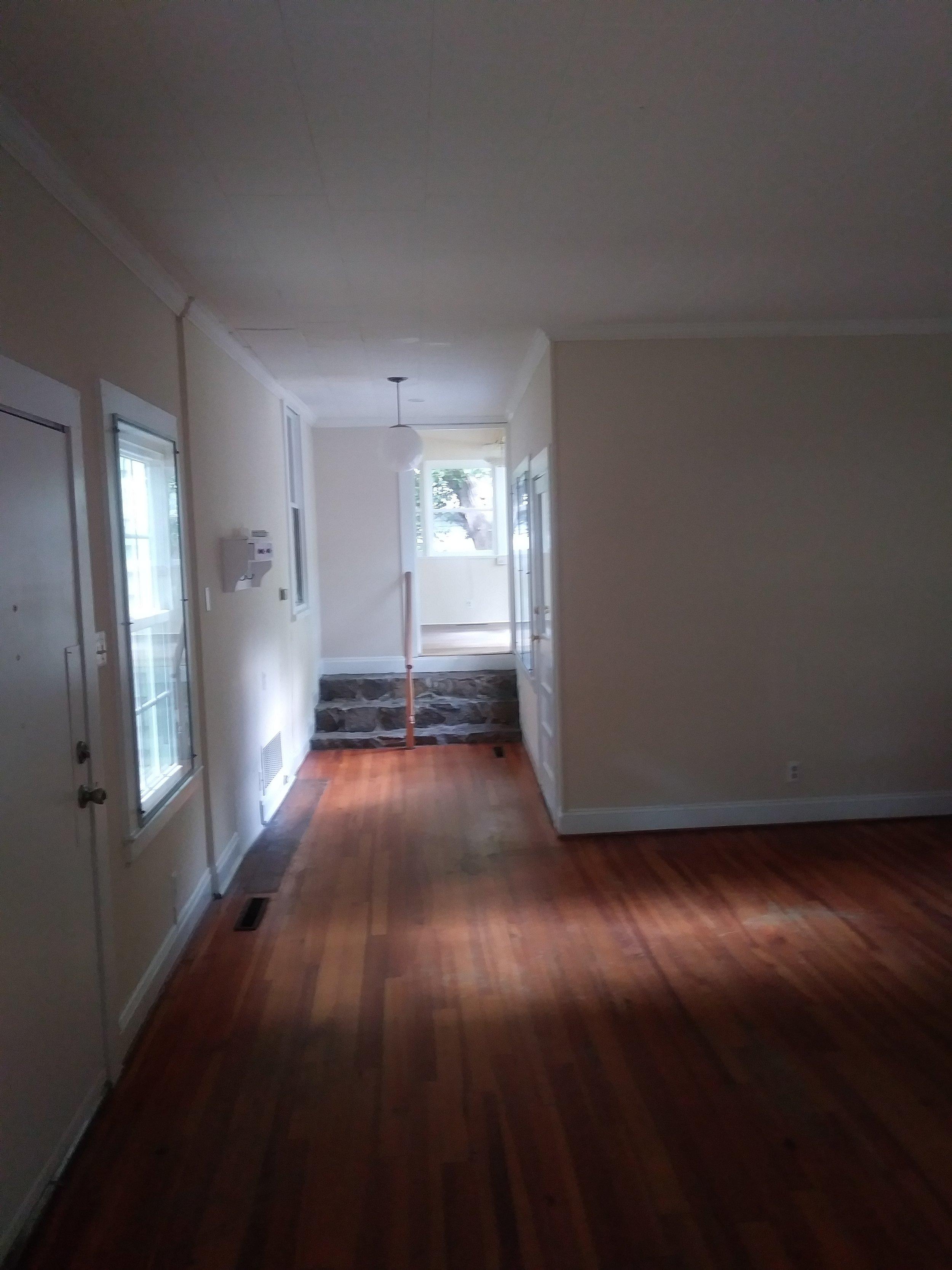 Cottage Lane, 204 - Living Room looking toward DR.jpg