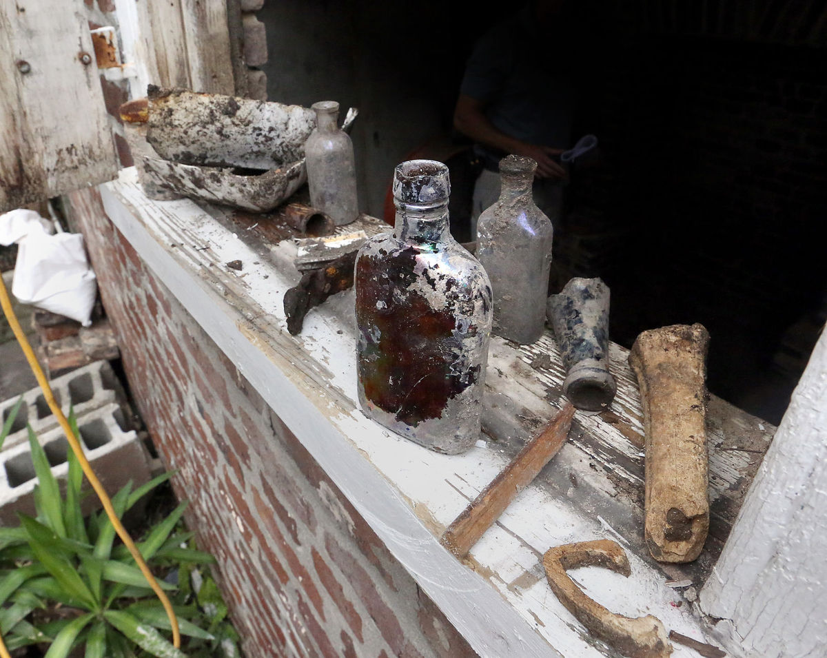 An excavation of a privy behind the Ansonborough home turned up these old items, including many bottles and buttons. Brad Nettles/Staff.  Brad Nettles bnettles@postandcourier.com