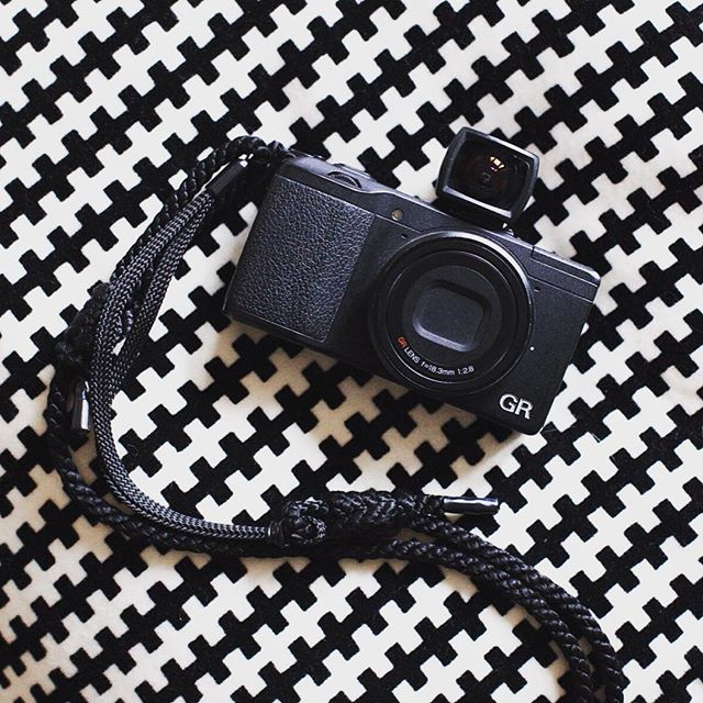My street photography tool of choice.  #28mm #ricohgr #ovf #customstrap #stealth