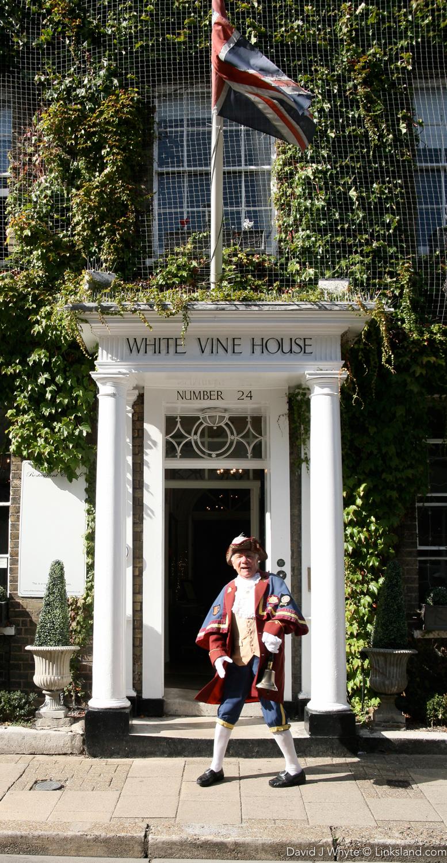 Rye's Town Crier - the Google of Yesteryear - outside Rye's White Vine House Hotel