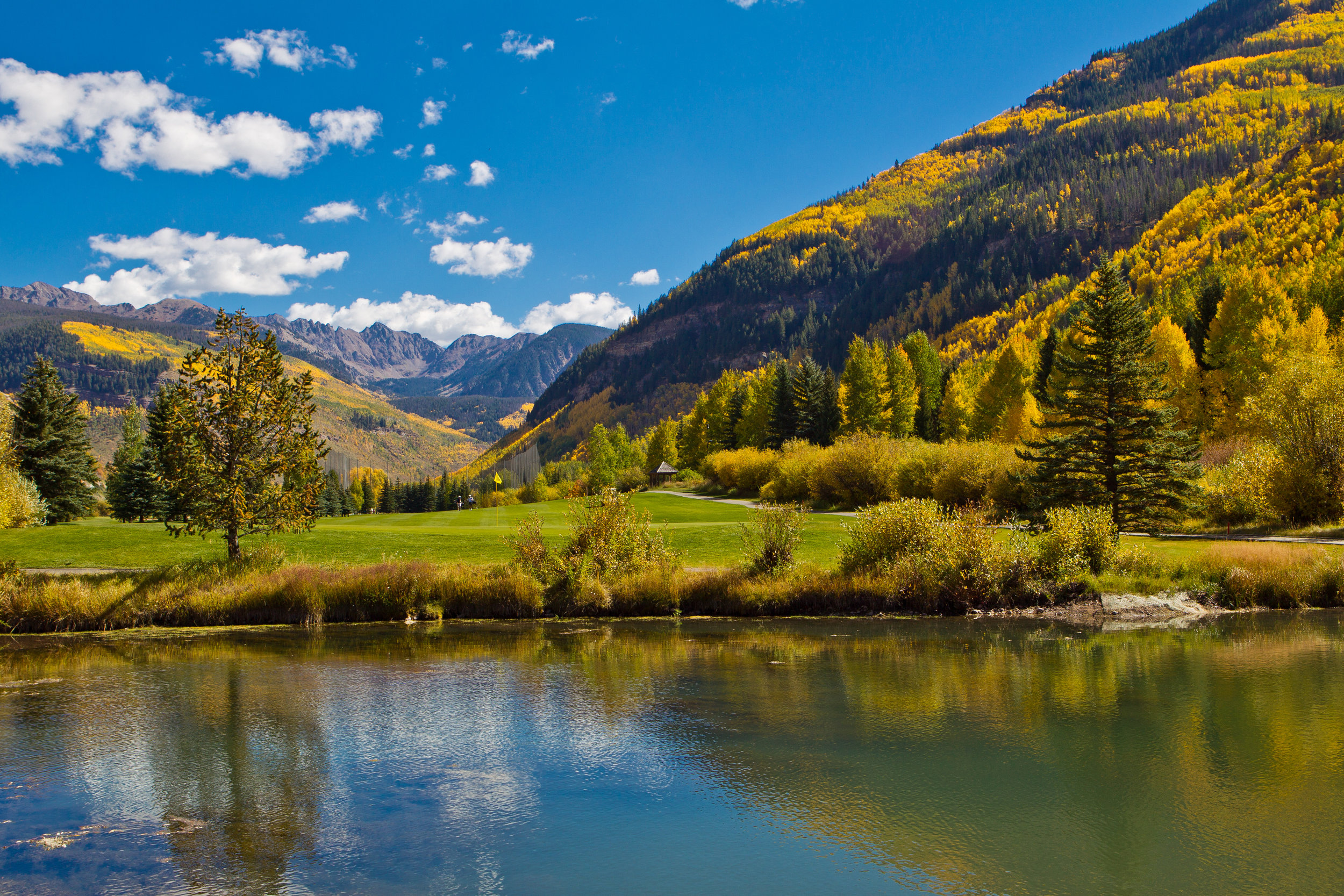 Vail Golf Club is looked over by the Gore Mountain Range