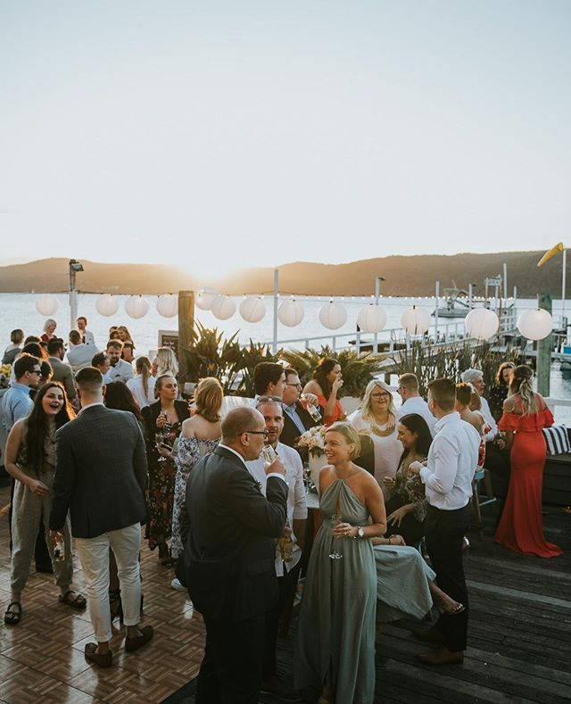 Wedding guests on the deck⁠ Photo |⁠ #theboathousegroup #theboathousepalmbeach #weddings #events #watersidevenue