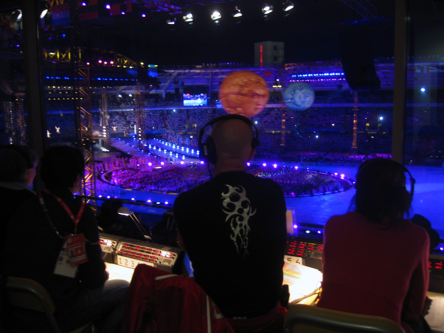 View of the Opening Ceremony behind Doug Jack, the head choreographer. Note the Riedel panels.