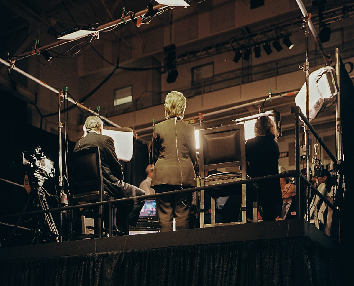 The media interviews after the debate. Photo by Harlan Erskine.
