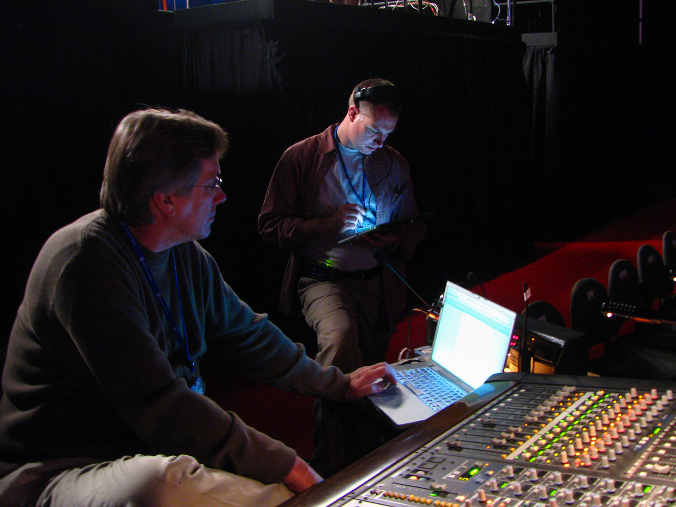 Mike Abbott at the FOH console and Kelly Epperson adjusting the system EQ.