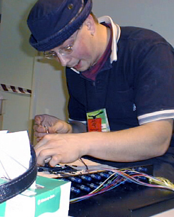 Rowan Goss terminating some of the 267 fiber circuits which Best Audio connected.