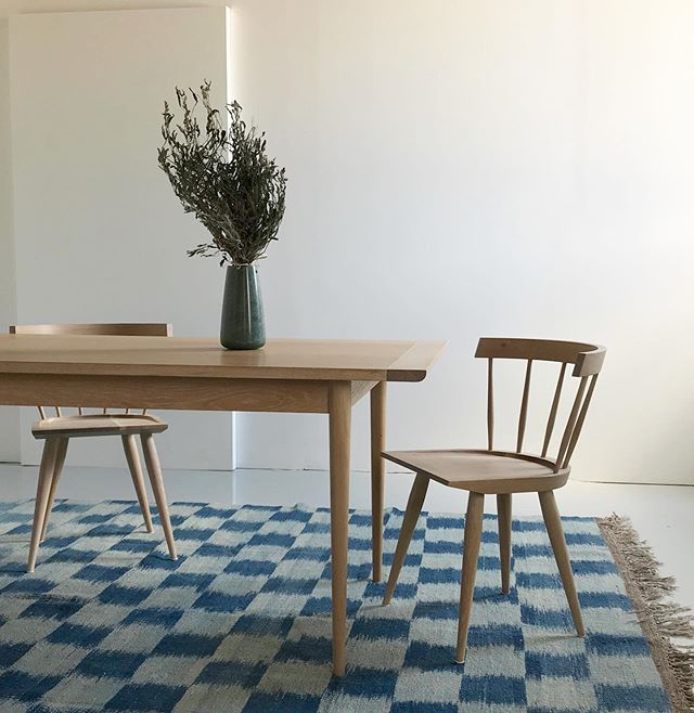 Lakeshore table and Edwins bathing in the dusky morning light.  Tibetan indigo-dyed rug courtesy of @ateliernomade .  #smallbatch #diningroom #diningtable #whiteoak #windblownsage