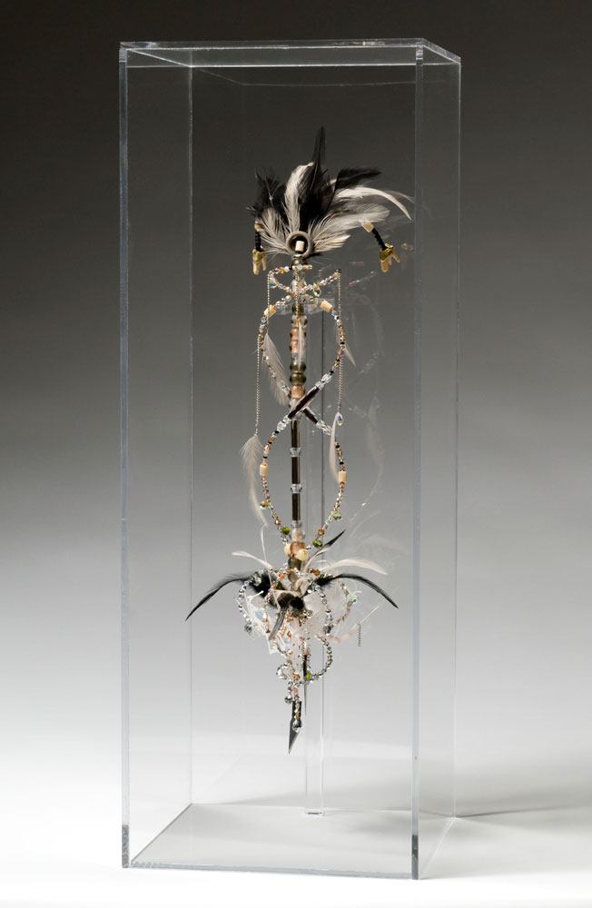 Normal   0   0   1   25   146   Artist   1   1   179   11.1287                      0       0   0              Talisman (QRO),  2008 Crystal, glass, wood, silver-plated, ceramic and bone beads, feathers, deer teeth, sewing needles, xacto blades, morse code 17 x 5 x 5 in | 43 x 13 x 13 cm