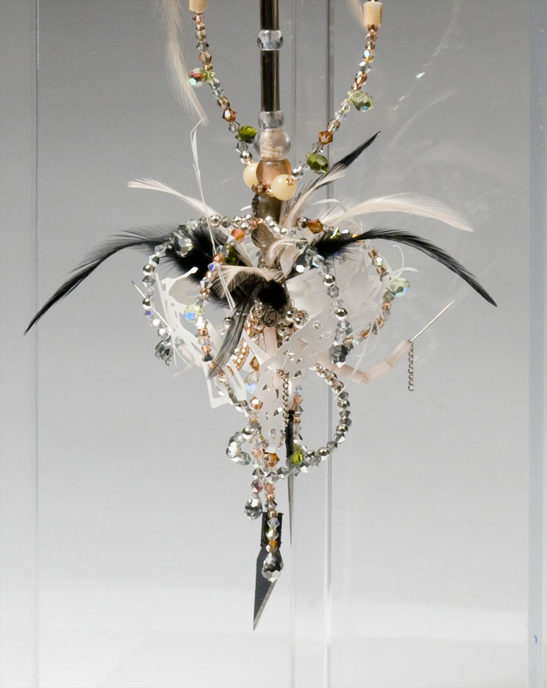 Talisman (QRO) (detail view bottom),  2008   Crystal, glass, wood, silver-plated, ceramic and bone beads, feathers, deer teeth, sewing needles, xacto blades, morse code   17 x 5 x 5 in | 43 x 13 x 13 cm