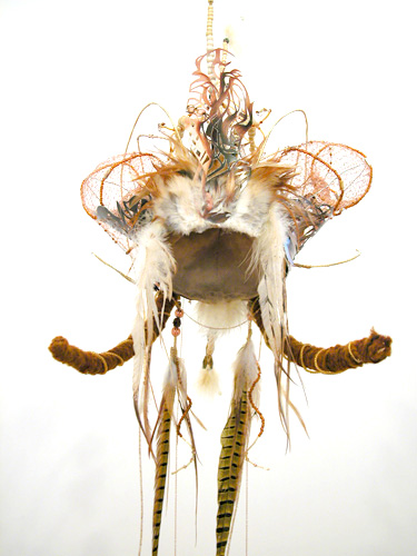 Headdress #1  (detail front),2006 Metal, foam, jade, turquoise, crystal, glass, bone, wood, clay, metal beads, feathers, gold & copper wire, suede, yarn, copper chain, magazine cutout, and acrylic paint Variable dimensions